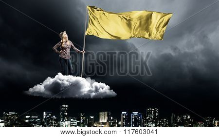 Woman with yellow waving flag