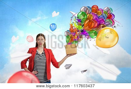 Girl holding box in hand