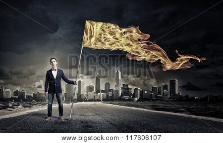 Man with orange waving flag