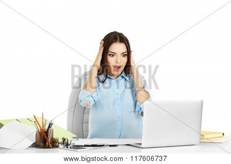 A beautiful emotional woman working at the office, isolated on white