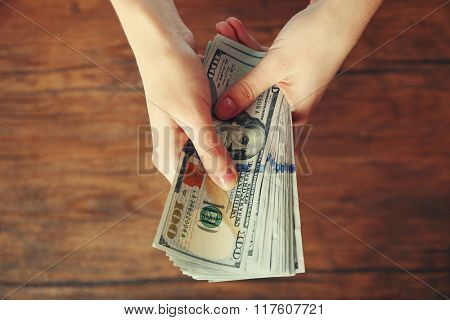 Hands holding money banknotes. Concept of payment and savings.