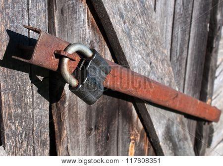 Padlock On The Wooden Door.