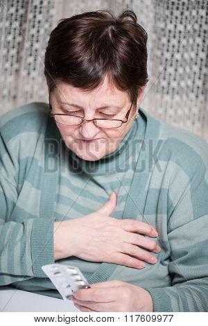 Senior Woman Holding Pills