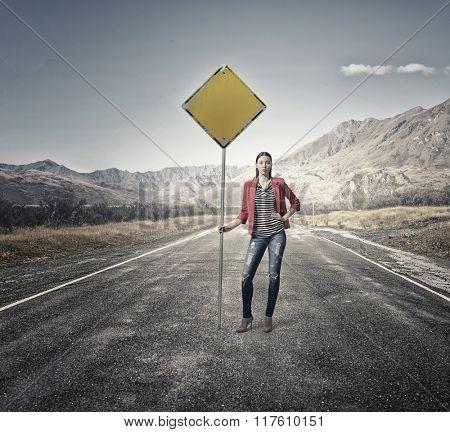 Pretty girl on asphalt road