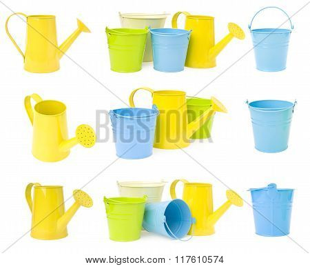 colorful buckets and watering can isolated on white background.