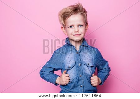 Portrait of happy joyful beautiful little boy. Studio portrait over pink background