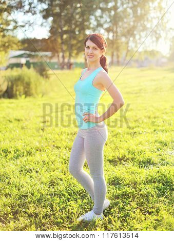 Sport, Fitness Concept - Beautiful Smiling Woman Preparing To Run