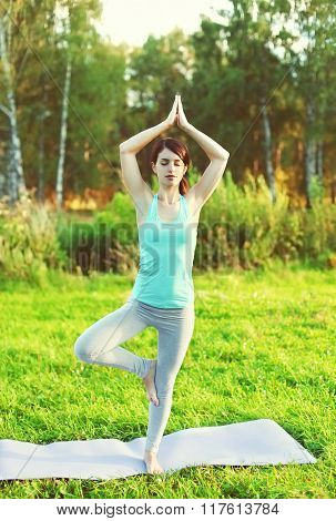 Woman Doing Yoga Exercises On Grass Outdoors Summer