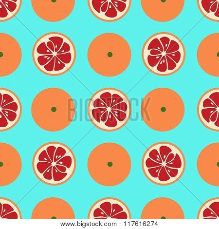 Cute seamless pattern with red grapefruit slices on blue background