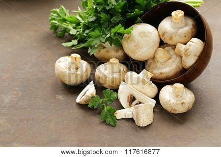 natural organic raw mushrooms champignons on table