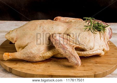Fresh Raw Duck Carcass On Wooden Cutting Board