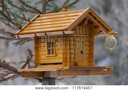 Decorative bird house made of wood