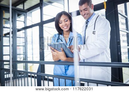 Doctor and nurse looking at tablet in the hospital