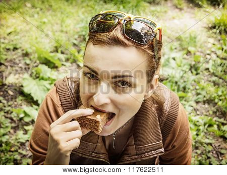 Young Woman Is Eating Tasty Gingerbread, Portrait In Outdoor