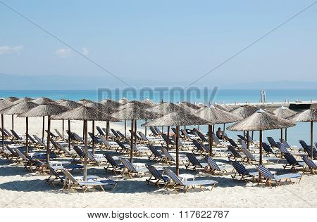 Umbrellas And Blue Sea In Greece.