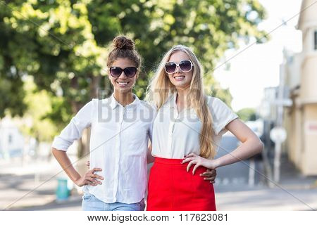Hip women smiling at the camera on the street