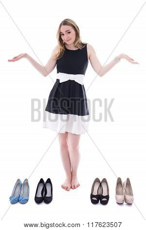 Shopping Concept - Beautiful Woman Choosing Shoes Isolated On White