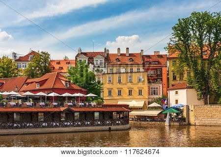 Typical colorful houses along Vltava river in Prague, Czech Republic.