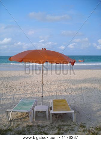 Two Deck Chairs Facing Beach At Bintan, Indonesia