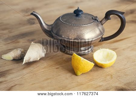 Old Teapot With Lemon And Ginger