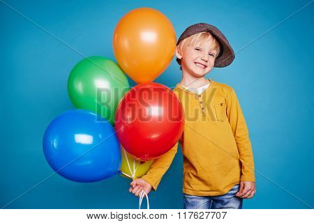 Cute boy with colorful balloons