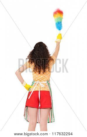 Young housewife holding duster - isolated on white background