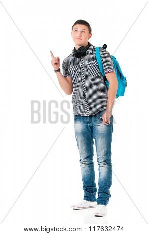 Young man with bag shows forefinger on something, isolated on white background