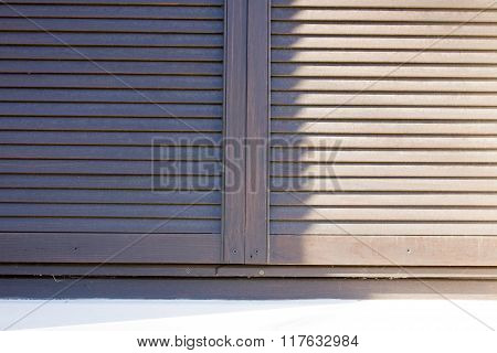 Shutters For Windows And Dark Wood