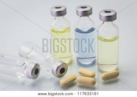 Medical Vials For Injection With Yellow Pills, Isolate