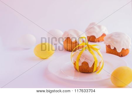 Easter Cake And Easter Eggs On The Plate On A White Background. Selective Focus.