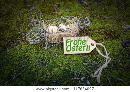 German 'frohe Ostern' (happy Easter) On Wooden Tag With Basket