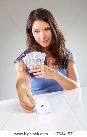 Woman Playing Cards With Ace Of Spades In Her Hand
