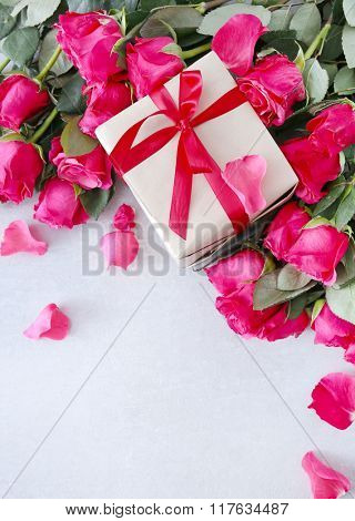 Valentine's day. Beautiful roses with a gift