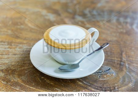 Close Up Coffee On Wood Table