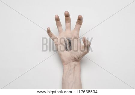 Suicide And Halloween Theme: The Human Hand Holding The Blade To Suicide Isolated On White Backgroun