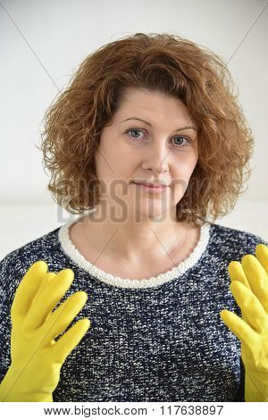 Woman With Rubber Gloves On His Hands