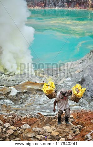 Kawah Ijen, Indonesia - December 30,2009 : Worker Carries Sulfur Inside Ijen Crater In Ijen Volcano,