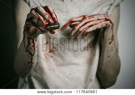 Depression And Bloody Halloween Theme: A Man Holding A Bloody Razor For Suicide On A Gray Background