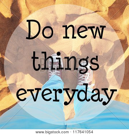 Desert sand with text: Do new things everyday