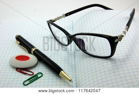 Notebooks, pens, glasses