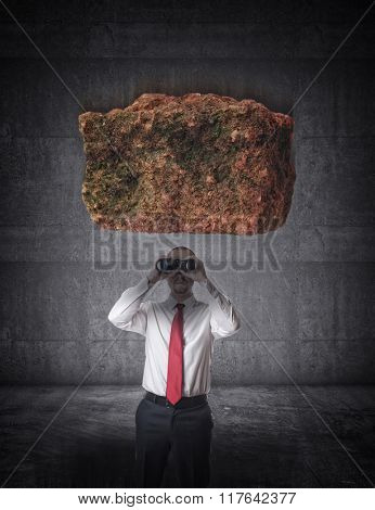 falling stone and businessman with binoculars