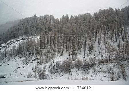 Snowy Zermatt with fog in Switzerland in winter. Zermatt is a municipality in Visp district of the canton Valais.