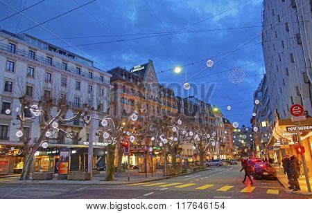 GENEVA SWITZERLAND - DECEMBER 31 2009: Street view on Geneva City center in Switzerland in winter. Geneva is the second most populous city in Switzerland. It is the capital of the canton Geneva