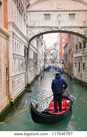 Venice, Italy - December 05, 2015: Gondolier on the Grand canal traveling in the area of Bridge of Sighs