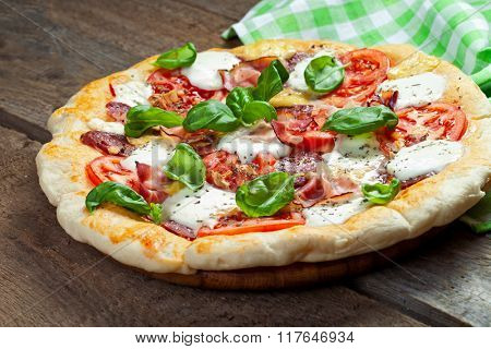 Pizza with salami, tomato and hamv