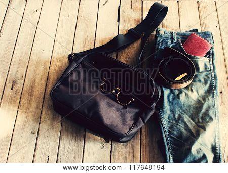Vintage Jean,wallet,sunglasses ,bag And Belt On Wood With Grunge Background