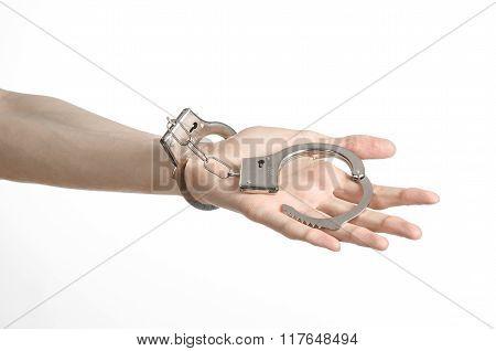 Prison And Convicted Topic: Man Hands With Handcuffs Isolated On White Background In Studio, Put Han