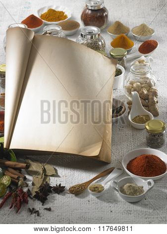 Blank recipe book with the spices.