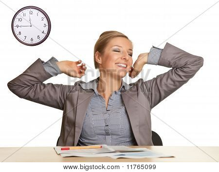 Woman in suit sitting at the desk isolated on white