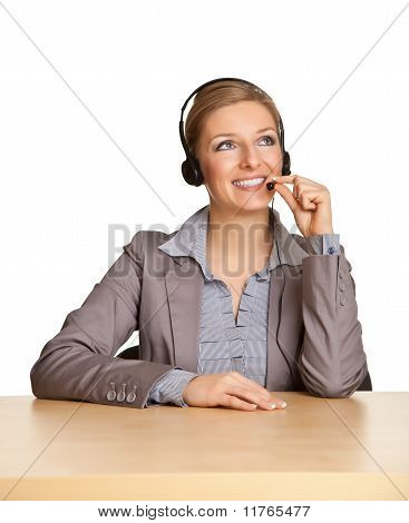 Woman in formal suit with headset isolated on white
